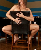 Nikki Sims on chair