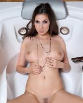 Connie Carter in a bathtub
