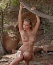 Busty blonde Cikita posing nude